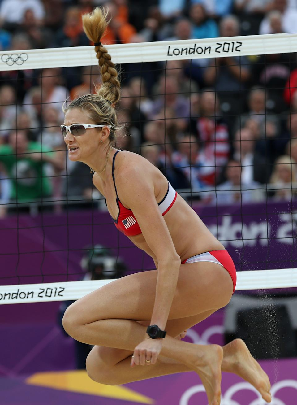 US Kerri Walsh Jennings reacts during the semifinal women's beach volleyball match against China at the 2012 Summer Olympics, Tuesday, Aug. 7, 2012, in London. (AP Photo/Petr David Josek)