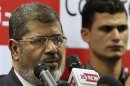 Muslim Brotherhood's presidential candidate Mohamed Morsy addresses a news conference in Cairo