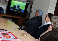 Bosnian Muslim women, survivors of the 1995 Srebrenica massacre, watch in Sarajevo a live television broadcast of the first day of trial of former Bosnian Serb army commander Ratko Mladic before the International Criminal Tribunal for the former Yugoslavia (ICTY) in The Hague