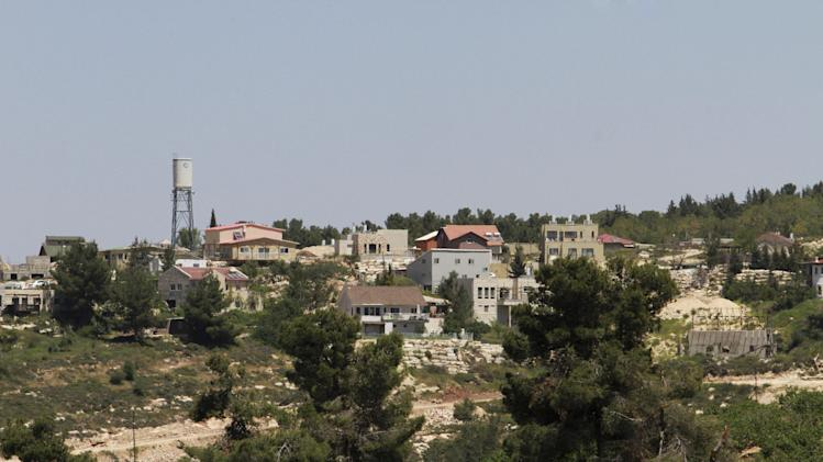 This Friday, April 18, 2014 photo shows the Jewish settlement of Bat Ayin, north of the West Bank city of Hebron. The settlement is known for its hardline population. While Israeli settlers in the West Bank fall mostly under civilian rule, Palestinians are subject to Israeli military law. Israeli and Palestinian youths face inequities at every stage in the path of justice, from arrests to convictions and sentencing, according to police statistics obtained by The Associated Press through multiple requests under Israel's freedom of information law. (AP Photo/Nasser Shiyoukhi)