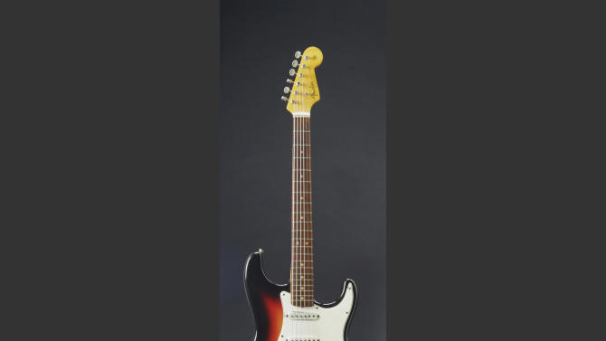 This undated photo provided by Christie's Auction House shows the Fender Stratocaster a young Bob Dylan played at the historic 1965 Newport Folk Festival. The festival was a defining moment that marked Dylan's move from acoustic folk to electric rock 'n' roll. The guitar was sold at auction on Friday, Dec. 6, 2013 for $965,000. (AP Photo/Christie's Auction House, File)