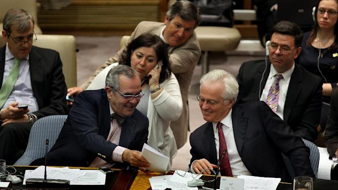 Russia's U.N. Ambassador Vitaly Churkin, right, laughs Saturday, April 14, 2012, with Ambassador Jose Filipe Moraes Cabral of Portugal at U.N. headquarters after a unanimous vote authorizing the deployment of the first wave of U.N. military observers to monitor a cease-fire between the Syrian government and opposition fighters which appears to be largely holding. (AP Photo/Craig Ruttle)
