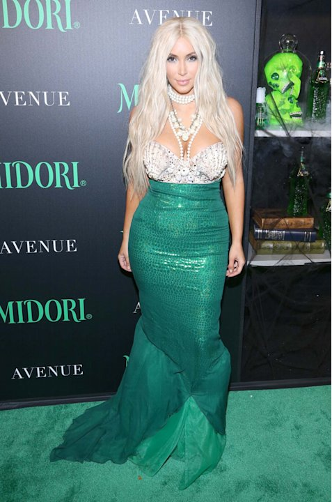 Kim Kardashian shocked us all with a Twitpic showing her blonde hair – but then we realised that it was just part of her mermaid Halloween costume. Phew. Copyright [Splash]