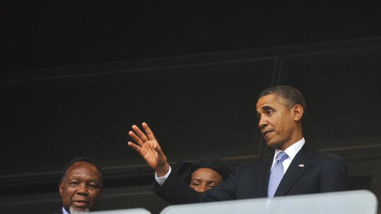U.S. President Obama and South African Deputy President Motlanthe attend the Memorial Service for former South African President Mandela in Johannesburg