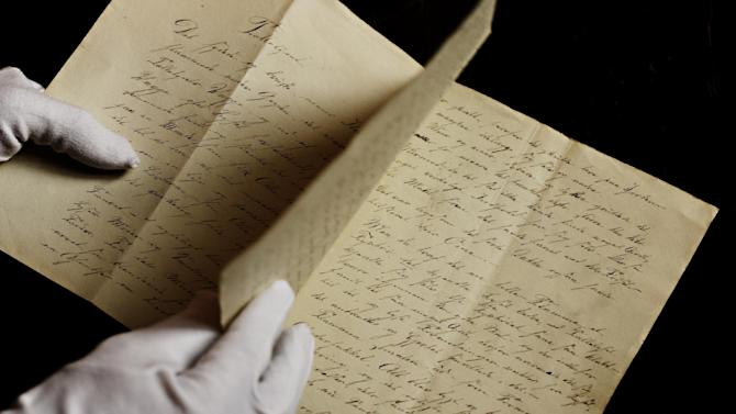 A newly found manuscript of a fairy tale by Hans Christian Andersen which has been located in Odense, pictured in the State Archives in Copenhagen,  Denmark  Wednesday, Dec. 12, 2012. The story of 'The Tallow Candle' might have been written about 1823, when he was 18 year old. (AP Photo/POLFOTO, Martin Bubandt)  DENMARK OUT