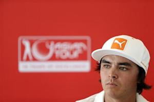 U.S. golfer Rickie Fowler addresses a news conference at the Kuala Lumpur Golf and Country Club in Kuala Lumpur