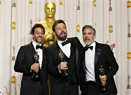 Best picture winner &quot;Argo&quot; producers George Clooney (R), Grant Heslov and Ben Afleck (C) pose with their awards at the 85th Academy Awards in Hollywood, California February 24, 2013 REUTERS/ Mike Blake