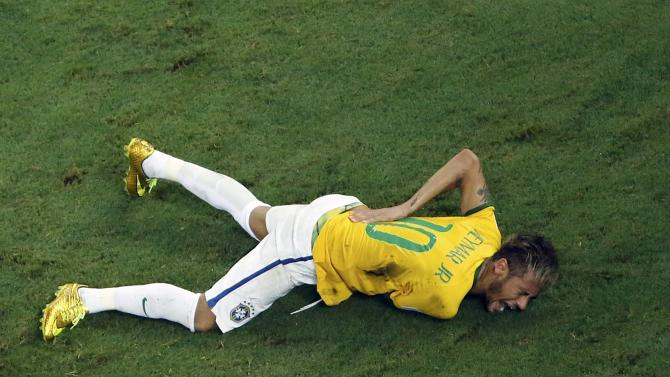 Brazil's Neymar grimaces after a challenge by Colombia's Zuniga during their 2014 World Cup quarter-finals against Colombia at the Castelao arena in Fortaleza