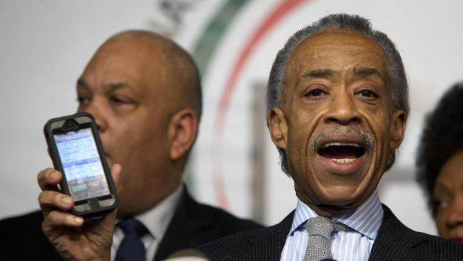Civil rights activist Reverend Al Sharpton plays a voicemail he says he received following the fatal shooting of two police officers, in Brooklyn