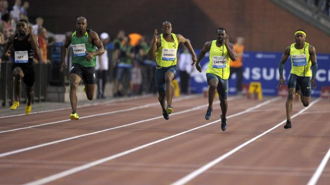 Athletes compete during the men's 100 metres at the IAAF Diamond League athletics meet in Brussels