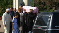 Mourners carry the casket of the two-year-old girl out of the Edmonton mosque after the service Saturday.