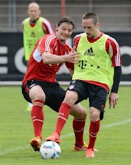 Bayern Munich's Franck Ribery (R) and Daniel van Buyten take part in a training session at the club's training grounds in Munich, southern Germany, on May 3. Bayern play Cologne next, at Rhein Energie Stadion in Cologne, on Saturday