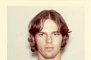 This 1977 booking photo provided by the Anaheim, Calif. Police Department shows Brett Matthew Paul Thomas, 18. On Friday, April 17, 2015, the convicted serial killer who went on a nine-day rampage that claimed the lives of four people in 1977 was denied parole and cannot reapply for seven years. Thomas, now 56, and his friend, Mark Titch, were convicted of the murders which were committed during robbery or burglary attempts in Orange County. (Anaheim Police Department, The Orange County Register via AP)