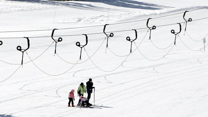 FILE - In this Feb. 19, 2013, file photo, skiers take the slopes at Alta Ski Resort in Little Cottonwood Canyon near Salt Lake City. Attorneys for the U.S. Forest Service say in court arguments filed this week that the decision by the Alta ski area in Utah to promote a snowboarder-free experience to lure skiers is a rational finding that violates no constitutional rights. Four snowboarders filed the lawsuit in federal court in January. They're claiming discrimination on national forest lands that make up most of the Alta ski area in the mountains east of Salt Lake City. (AP Photo/The Deseret News, Jeffrey D. Allred, File) ) SALT LAKE TRIBUNE OUT, MAGS OUT, MANDATORY CREDIT.