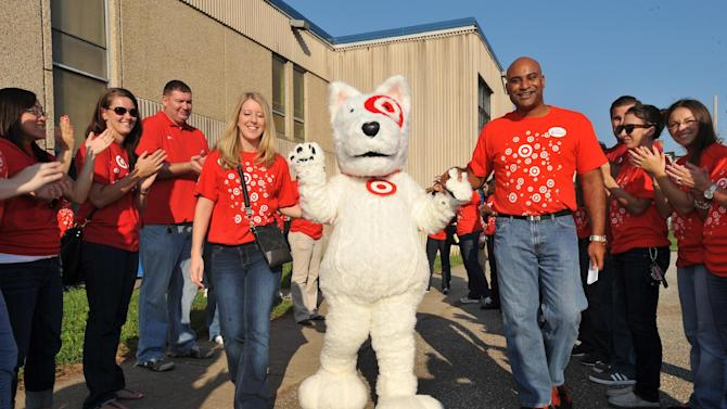 Target representative, David Anderson, and Bullseye the Target dog, hurry to the stage, cheered on by fellow Target team members. David announced the $25,000 grant and special surprise for students and teachers at Baltimore's Sarah M. Roach Elementary School. The celebration took place on Thursday, Aug. 30, 2012 in Baltimore, MD, as part of the Give With Target initiative. Learn more at http://abullseyeview.com/category/give-with-target. (Photo by Larry French/Invision for Target/AP Images)