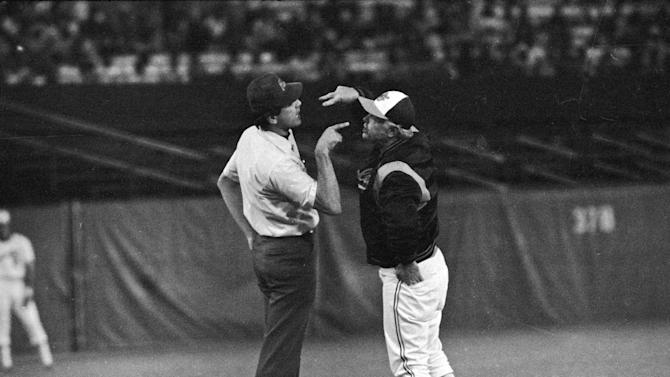 FILE - In this Aug. 16, 1979 file photo, Baltimore Orioles manager Earl Weaver argues with third base umpire Steve Palermo, after Palermo ejected him during the second inning of a baseball game against the Kansas City Royals, in Baltimore.  Weaver, the fiery Hall of Fame manager who won 1,480 games with the Baltimore Orioles, has died, the team announced Saturday, Jan. 19, 2013. He was 82. (AP Photo/File)