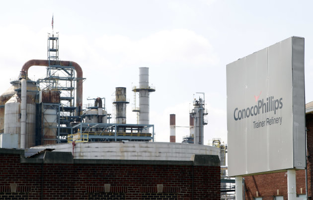 In a Thursday, April 19, 2012 photo, the ConocoPhillips refinery is seen in Trainer, Pa. ConocoPhillips on Monday, April 23, 2012 reported first-quarter earnings of $2.9 billion, compared with first-quarter 2011 earnings of $3.0 billion. Excluding $330 million of special items, first-quarter 2012 adjusted earnings were $2.6 billion. Special items were primarily related to gains on asset dispositions, partially offset by impairments and repositioning costs. (AP Photo/Alex Brandon)