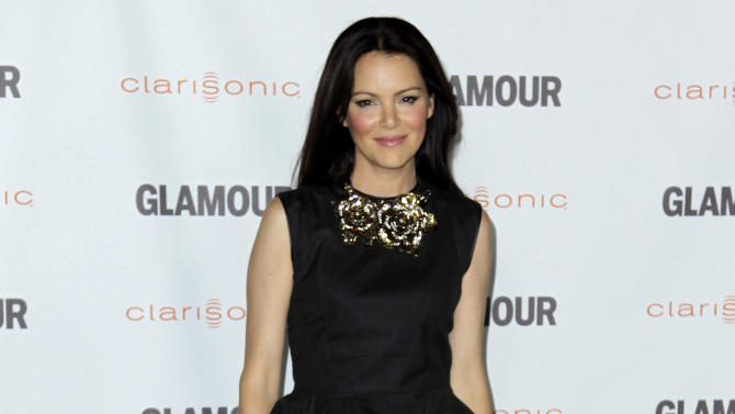 "Actress Jacinda Barrett arrives at a screening for ""Glamour Reel Moments"" in Los Angeles, Monday, Oct. 24, 2011. ""Glamour Reel Moments"" is a short film series that turns personal stores submitted by Glamour readers and turns them into short films. (AP Photo/Matt Sayles)"