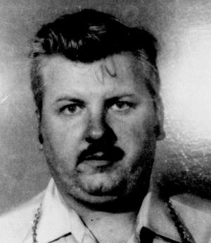 FILE - This 1978 file photo shows serial killer John Wayne Gacy. On Tuesday, Nov. 29, 2011, Cook County Sheriff Tom Dart announced that his office has identified a previously unknown victim of  Gacy as 19-year-old William George Bundy. It came nearly seven weeks after his office sought the DNA of relatives of people who disappeared in the 1970s to look for matches with the remains of eight young men who were never identified. Gacy was convicted of murdering 33 young men between 1972 and 1978. He buried most of the bodies in a crawl space under his home. (AP Photo/File)