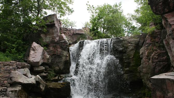 This June 5, 2013 photo shows the Winnewissa Falls at Pipestone National Monument in Minnesota. More than 50 Native Americans travel to Pipestone to quarry catlinite _ sheets of stone _ that will then be carved into pipes used in traditional ceremonies. For visitors, the site offers a museum and trail that includes the waterfall. (AP Photos/Kristi Eaton)