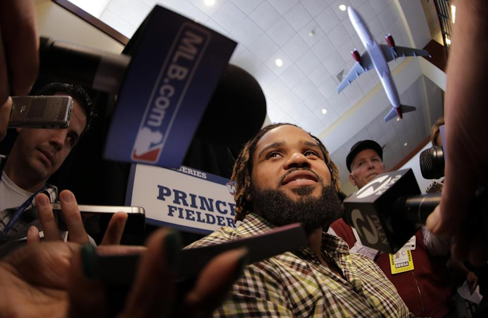 Detroit Tigers' Prince Fielder answers reporters questions before a workout for baseball's World Series Tuesday, Oct. 23, 2012, in San Francisco. The Tigers play the San Francisco Giants in Game 1 on Wednesday, Oct. 24. (AP Photo/Charlie Riedel)