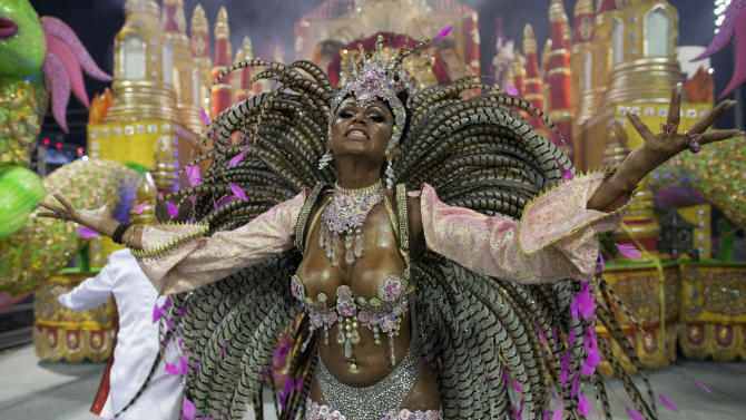 A dancer from the X-9 Paulistana samba school performs during a carnival parade in Sao Paulo, Brazil, early Saturday, Feb. 9, 2013. (AP Photo/Andre Penner)