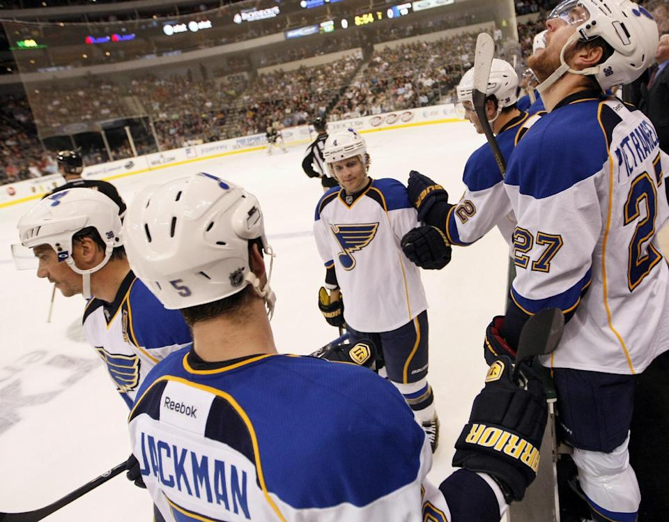 St. Louis Blues defenseman Kris Russell (4) is congratulated by teammates after scoring a goal against the Dallas Stars during the second period of an NHL Hockey game, Saturday, April 7, 2012, in Dallas. (AP Photo/Brandon Wade)