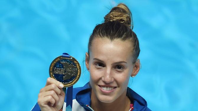 Italian diver Tania Cagnotto won gold with 310.85pts in the women's 1m springboard final at the world championships in Kazan