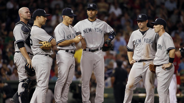 New York Yankees, left to right, Brian McCann, Mark Teixeira, Joe Girardi, Derek Jeter, Chase Headley and Stephen Drew wait on the mound during a pitching change in the seventh inning of the Yankees' 4-3 loss to the Boston Red Sox in a baseball game at Fenway Park in Boston on Friday, Aug. 1, 2014. (AP Photo/Winslow Townson)