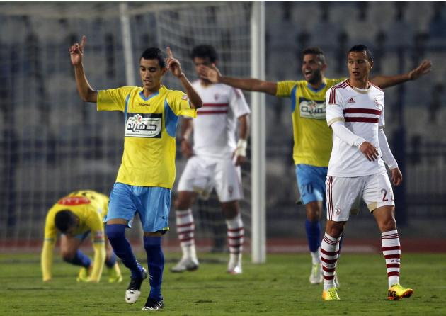 El Ismaily players celebrate after they win their opening Egyptian Premier League derby soccer match against El Zamalek at Cairo Stadium