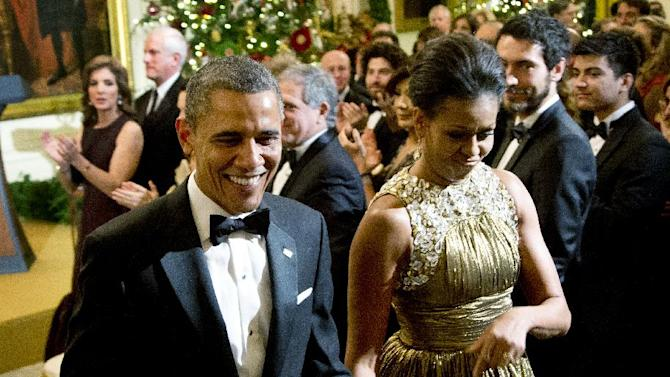 President Barack Obama and first lady Michelle Obama leaves a reception in honor of the 2012 Kennedy Center Honors recipients, in the East Room of the White House in Washington, Sunday, Dec. 2, 2012. At the back left is Caroline Kennedy. (AP Photo/Manuel Balce Ceneta)
