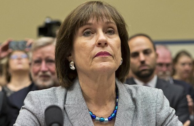 In this May 22, 2013, photo, Lois Lerner listens on Capitol Hill in Washington. A day after she refused to answer questions at a congressional hearing, Lerner has been replaced as director the Interna