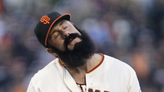FILE - In this July 10, 2011, file photo, San Francisco Giants pitcher Brian Wilson adjusts his neck during the ninth inning of a baseball game against the New York Mets in San Francisco. Wilson is likely headed for surgery on his right elbow after an MRI showed structural damage and an issue with the ligament, and his season could be in jeopardy. Manager Bruce Bochy and athletic trainer Dave Groeschner say the club will seek at least one other opinion and probably two, including from the renowned orthopedist Dr. James Andrews, who performs Tommy John elbow-reconstruction surgeries. (AP Photo/Ben Margot, File)