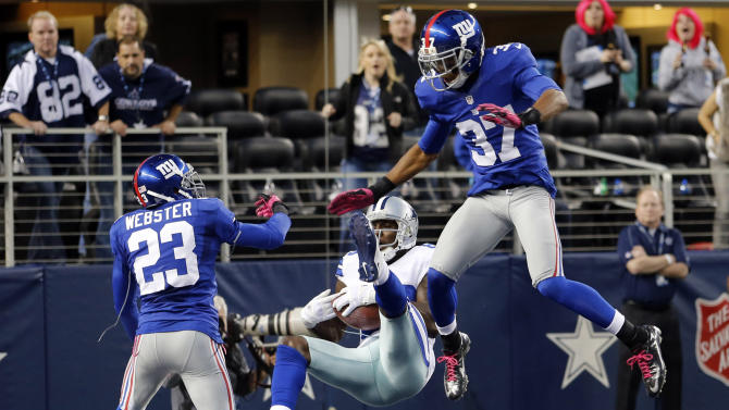 Dallas Cowboys wide receiver Dez Bryant (88) makes a last-minute reception between New York Giants cornerbacks Corey Webster (23) and Michael Coe (37) for a touchdown that was nullified after review during an NFL football game, Sunday, Oct. 28, 2012, in Arlington, Texas. The Giants won 29-24. (AP Photo/Sharon Ellman)