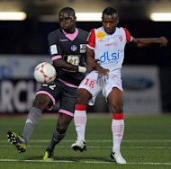 Toulouse&#39;s midfielder Moussa Sissoko (L) clashes with Nancy&#39;s midfielder Lossemy Karaboue during their French L1 football match at Marcel Picot Stadium, in Tomblaine, eastern France. Toulouse won 1-0