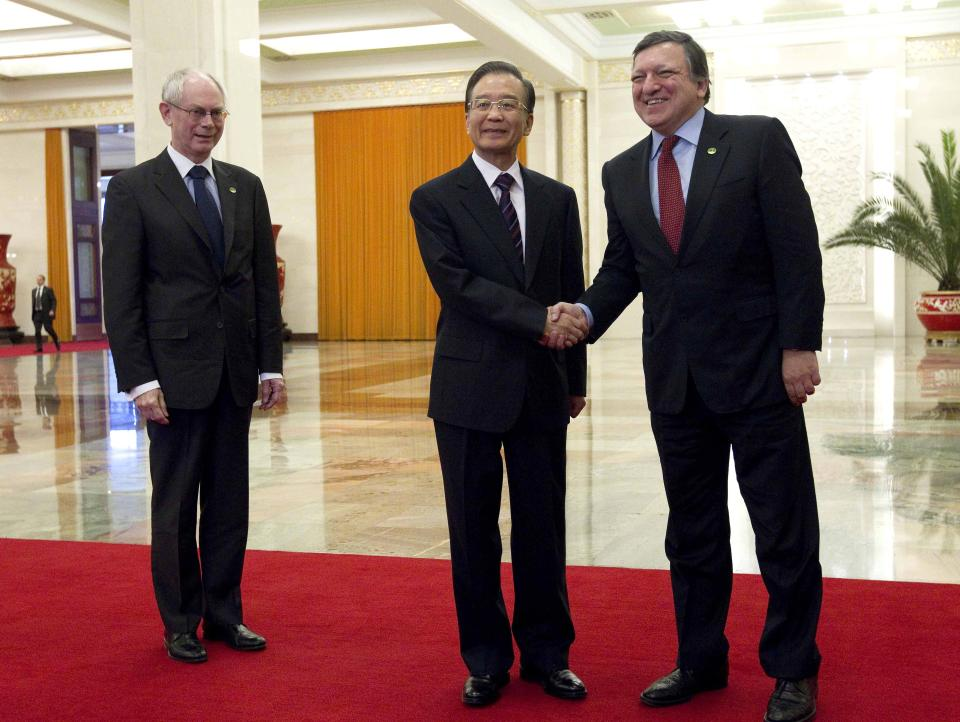 EU Commission President Jose Manuel Barroso, right, shakes hands with Chinese Premier Wen Jiabao beside EU President Herman Van Rompuy at the Great Hall of the People during their summit in Beijing Tuesday, Feb. 14, 2012. (AP Photo/How Hwee-young, Pool)