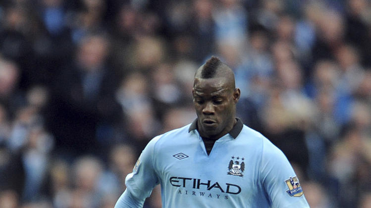 FILE - This Dec. 9, 2012 file photo shows Manchester City's Mario Balotelli during a Premier League soccer match against Manchester United at the Etihad Stadium in Manchester, England. AC Milan says Tuesday, Jan. 29, 2013 that it has reached an agreement with Manchester City to sign Mario Balotelli and the Italy striker will undergo a medical on Wednesday. Balotelli is then expected to sign a four-and-a-half year deal with Milan, until 2017.  (AP Photo/Clint Hughes, files)