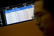 An employee watches trading of Felda Global shares on an electronic screen shortly after their stock market debut at Malaysia Stock Exchange in Kuala Lumpur, on June 28. Shares in Malaysian palm oil giant jumped 18.46% on its stock market debut defying global economic doldrums with the world's second-largest IPO this year after Facebook