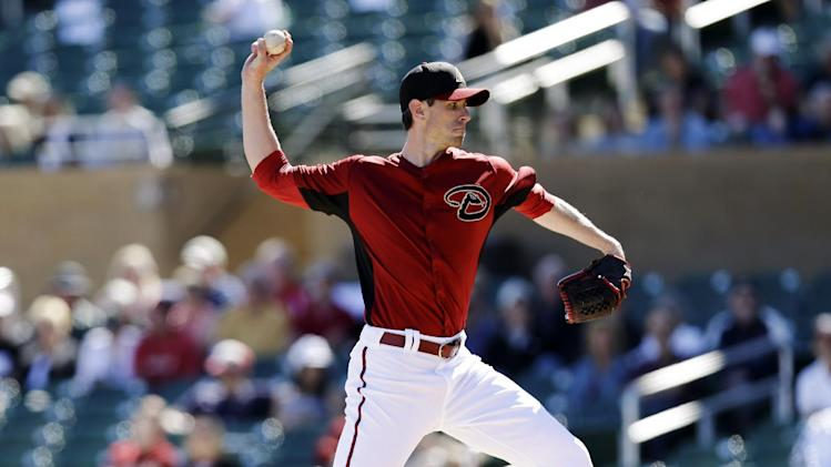 Arizona Diamondbacks starting pitcher Brandon McCarthy throws to the Cincinnati Reds during the first inning of an exhibition spring training baseball game, Wednesday, Feb. 27, 2013, in Scottsdale, Ariz. (AP Photo/Marcio Jose Sanchez)