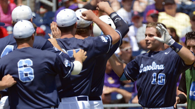 North Carolina's Brian Holberton (10) is greeted by teammates after hitting a two-run home run against LSU in the first inning of an NCAA College World Series elimination baseball game in Omaha, Neb., Tuesday, June 18, 2013. (AP Photo/Ted Kirk)
