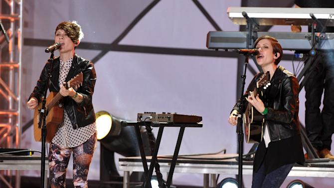 Tegan Quin, left, and Sara Quin, of musical group Tegan and Sara, perform at the mtvU Woodie Awards on Thursday, March 14, 2013, in Austin, Texas. (Photo by John Shearer/Invision for MTV/AP Images)