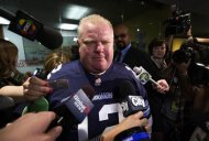 Toronto Mayor Rob Ford responds to unproven allegations about him making sexual comments about a female staffer, as he arrives at City Hall in a football jersey in Toronto, November 14, 2013. REUTERS/Mark Blinch