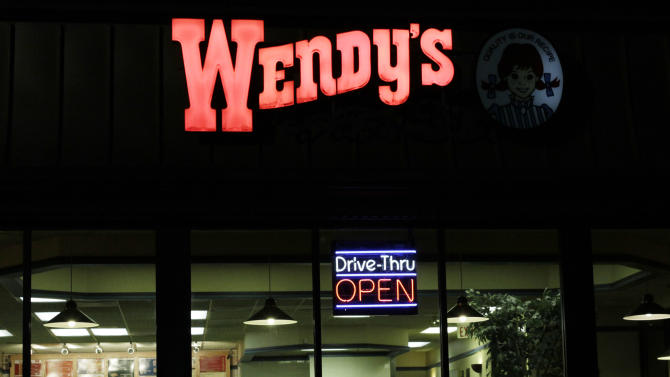 This Feb. 28, 2012 photo, shows a Wendy's restaurant at night in Brunswick, Maine. The Dublin, Ohio-based company on Thursday, March 1, 2012, its net income from continuing operations in the fourth-quarter was flat from a year ago. (AP Photo/Pat Wellenbach)