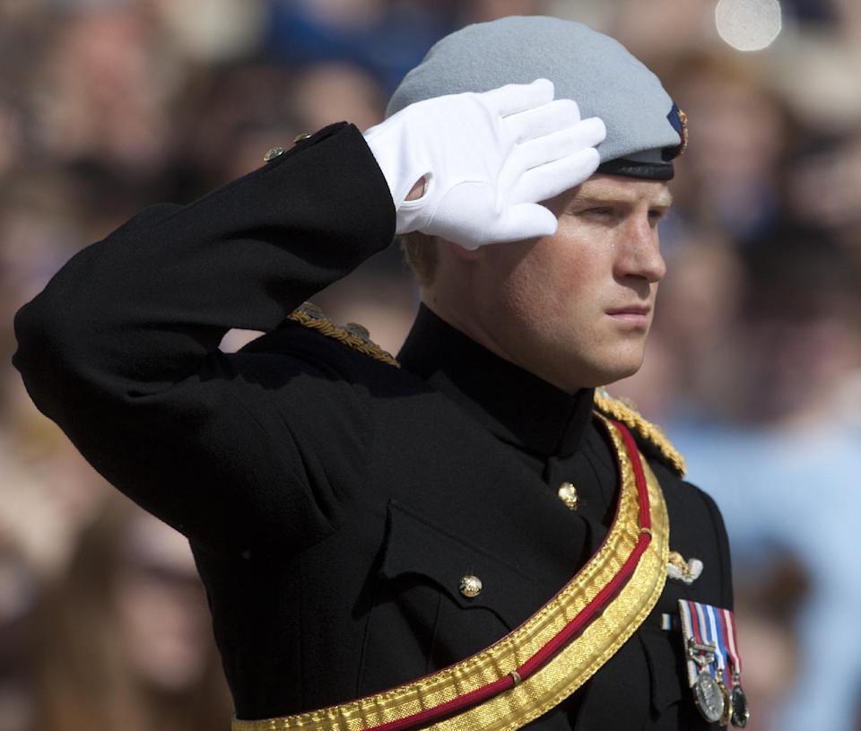 Prince Harry salutes during a wreath laying ceremony at the Tomb of the Unknowns at Arlington National Cemetery in Arlington, Va Friday, May 10, 2013. (AP Photo/Carolyn Kaster)