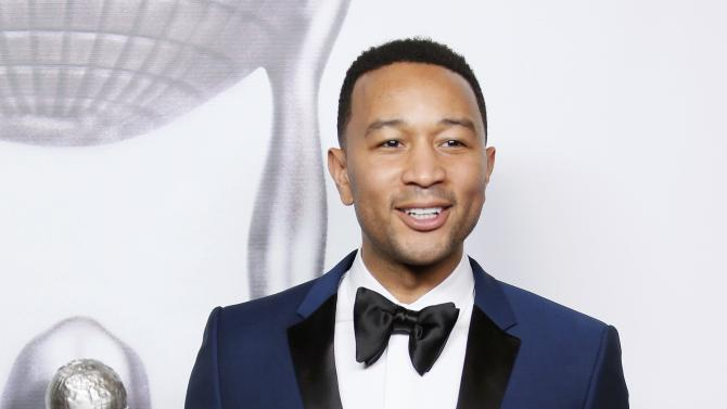 John Legend poses with his award during the 47th NAACP Image Awards in Pasadena