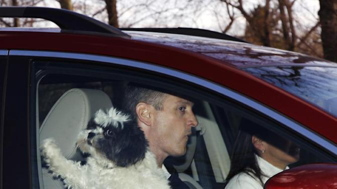 Former Rutgers head coach Mike Rice is driven from his home, Wednesday, April 3, 2013, in Little Silver, N.J. With political and social pressure mounting after video showed Rice screaming gay slurs and shoving, kicking and throwing balls at his NCAA college basketball players, the university fired Rice on Wednesday, and then did their best to avoid the blame for not getting it right four months ago. (AP Photo/Mel Evans)