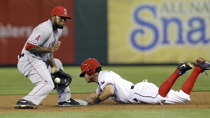 Los Angeles Angels second baseman Howard Kendrick (47) catches the pick off throw as Texas Rangers Ian Kinsler (5)  slides in safe to second base advancing fron first on a passed ball during the second inning of a baseball game Sunday, April 7, 2013, in Arlington, Texas. (AP Photo/LM Otero)