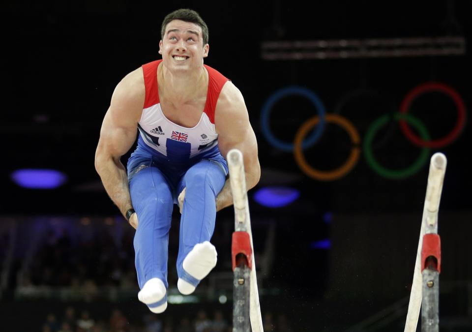 Great Britain's gymnast Kristian Thomas performs on the parallel bars during the Artistic Gymnastic men's qualification at the  2012 Summer Olympics, Saturday, July 28, 2012, in London. (AP Photo/Gregory Bull)