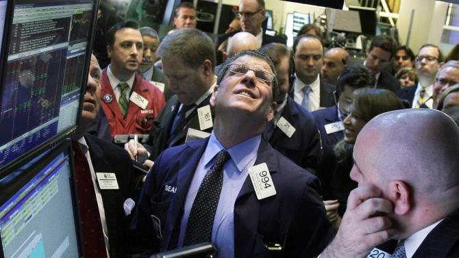 FILE - In this Thursday, Sept. 20, 2012, file photo, traders check the prices to begin trading on the floor of the New York Stock Exchange. Stocks fell on Friday, Sept. 28, 2012, after news that U.S. consumers spent more last month only because higher gas prices forced them to. (AP Photo/Richard Drew, File)