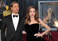 "Actress Angelina Jolie and actor Brad Pitt arrive on the red carpet for the 84th Annual Academy Awards on February 26, 2012 in Hollywood, California. Hollywood superstars Brad Pitt and Angelina Jolie may be heading to Australia if the government is successful in bringing ""20,000 Leagues Under the Sea: Captain Nemo"" Down Under, it emerged Friday"